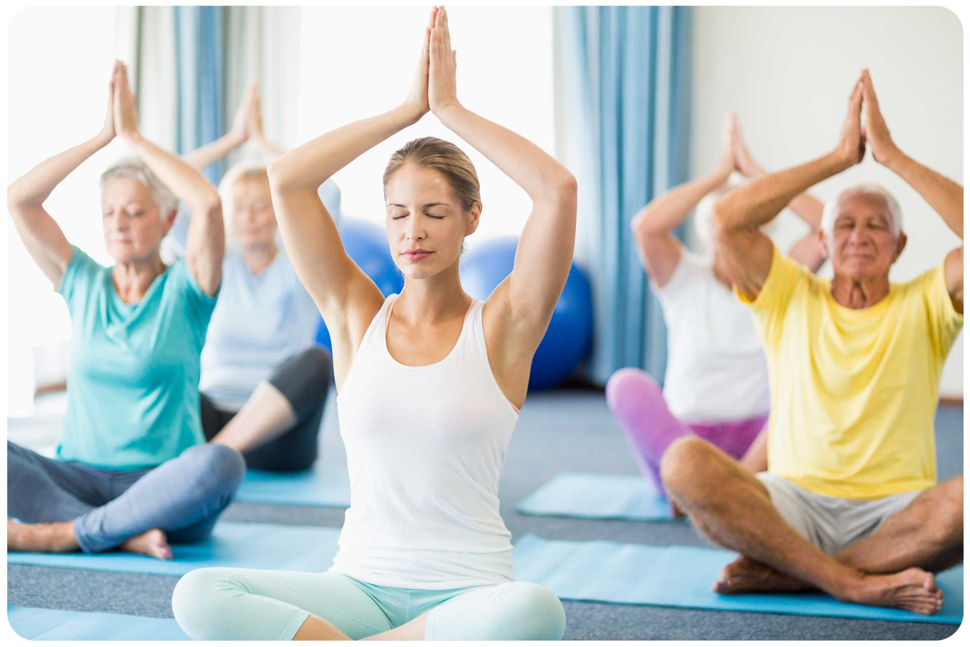 YOUga Focusing On Your Mind And Body In A Group Yoga Session