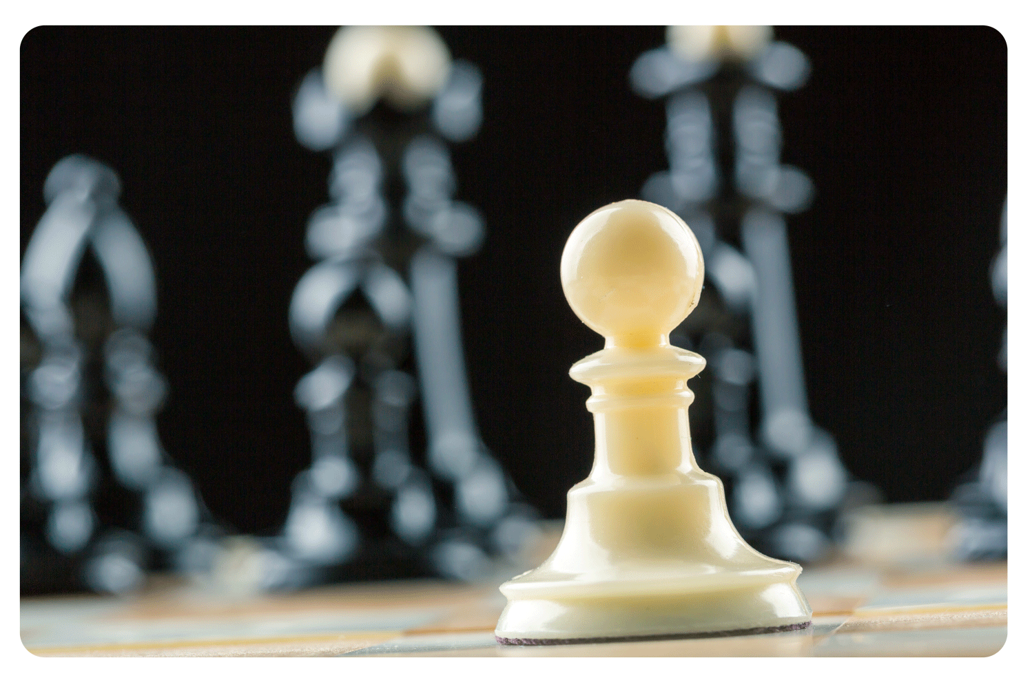 Pawn in Focus with Other Pieces in Soft Focus Behind It